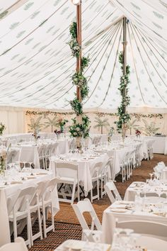 Wild Flower Filled Marquee by LPM Bohemia - Wild Flower Wedding For A Rustic Marquee Reception At Bride's Family Home | Image by Matilda Delves Photography