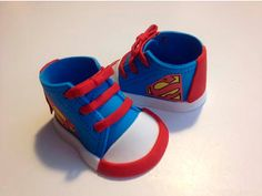 superman Fondant shoes cake toppers by Ninettacakes on Etsy Fondant Baby Shoes, Fondant Bow, Fondant Tutorial, Fondant Flowers, Fondant Cakes, Shoe Cakes, Cupcake Cakes, Car Cakes, Baby Shower Cakes