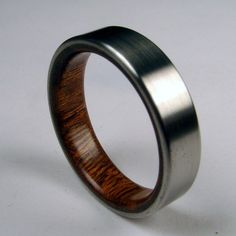 Narrow Rosewood and Titanium Band Wood Ring--Signature Series: Wood on the inside, titanium on the outside. Looks pretty cool and reminds me of a transformer.