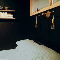 The magazine sconce above a bed provides enough light for reading in bed