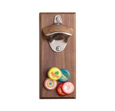 "This walnut-based wall mount can hold up to 30 caps the moment they go pop. Think about how much cleaner the counter will be.  <a href=""http://www.restorationhardware.com/catalog/product/product.jsp?productId=prod4640209"" target=""_blank""> Restorationhardware.com</a>, $38.99"