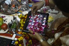 An Indian trader worships an iPad on Diwali. Since ages, the worshiping of account books has been an essential part of Diwali for the business community in India for prosperity of business. Signifying the modernization of the retail trade in India, some traders are now including the worshipping of electronic gadgets. The festival of Diwali celebrates the victory of good over evil, light over darkness and knowledge over ignorance.