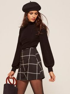 One of those you'll wear forever, also makes your legs look great. This is an a-line mini skirt with a center back zipper.