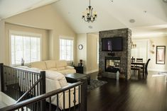 living room to dining room split with double-sided see-through fire place