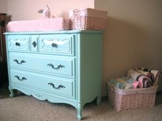 So cute! Love this aqua dresser. Color is Behr's Pooh's Favorite Things. Step by step instructions for painting the furniture is in this post.