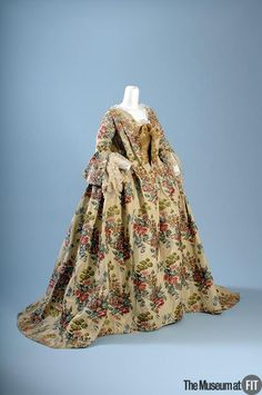 "1735 French/Italian Robe à la française at the Museum at FIT, New York - From the curators' comments: ""A fashionable robe à la française might be made from yards of expensive silk brocade draped over wide hoops, trimmed with handmade lace, and elaborately accessorized. Often dismissed as wasteful, aristocratic luxury supported a host of artisans."""
