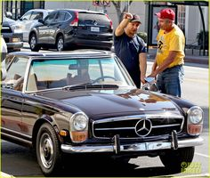 Jeremy Renner rocks athletic gear while buying a brand new classic car on Friday (October 24) in West Hollywood, Calif.