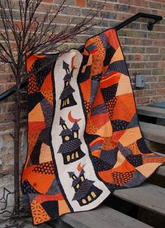 Simply Haunting quilt by ABBEY LANE QUILTS. Would look cute with string quilt blocks on either side also.