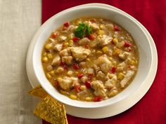 Slow Cooker White Chicken Chili...I'll be making some chicken chili tomorrow...minus the corn...and I;m not sure about the green taco sauce since I plan on chopping up fresh jalapenos along with the bell pepper...
