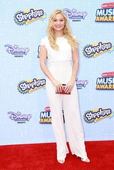 Olivia Holt carries KOTUR's embossed silver clutch to the 2015 Radio Disney Music Awards in Los Angeles, CA #olivia #holt #KOTUR #radio #disney #music #awards #LA #clutch #embossed #silver