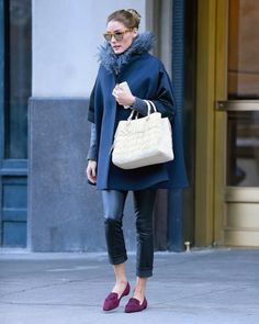 """February 11, 2015 - """"Olivia Palermo kicked of NYFW in a chic oversized cape complete with fur collar, leather skinnies, white fringe shopper, Westward Leaning sunnies, and tasseled maroon loafers."""""""