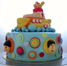 Lennon's birthday cake...he turned 1. The yellow submarine got lots of compliments, almost as many as Ringo's nose.