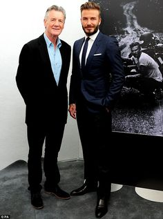 Suited and booted: The former footballer looked dapper in a dark blue suit as he posed with the comedian at London's Serpentine Gallery