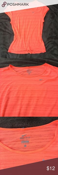 NIKE Bright orange top dry fit S gym tee Beautiful and bright orange color tee from NIKE; has silver tags! It's little bit see through! Very breathable and comfy material! Condition LIKE NEW!!!!!! I'm willing to answer any questions!  I have a lot of workout stuff, take a look into my closet and bundle more items to get discount from me as well as savings on shipping 😊 Nike Tops Tees - Short Sleeve