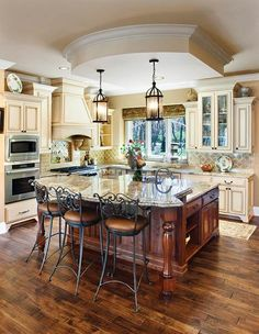 glazed cabinets + darker wood. Love the combo. Also like the movement in the countertops & varying heights of the cabinets.