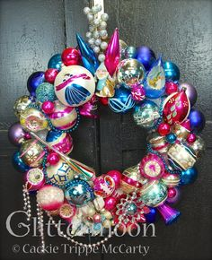 MAGENTA BLUES  For you deep pink and blue lovers here is a gorgeous wreath packed with so much terrific stuff. Notice the sly look that adorable