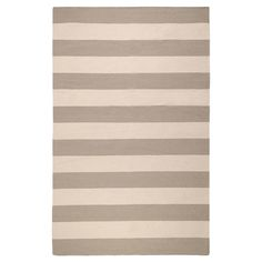 Anchor your living room seating group or define space in the den with this artfully hand-woven wool rug, showcasing bold stripes.