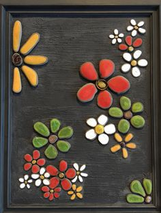 A colorful mix of stone flowers, with metal accents and a touch of sparkle on a textured charcoal background. Housed in a vintage charcoal frame. A diversion from my trademark daisies, this colorful m