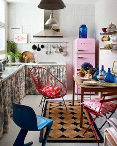 This colorfully bohemian apartment in Madrid exudes good vibrations. Carmen, the owner and founder of an online store, is the inspirer of this joyful result. I love the happily mismatched chairs. | Tiny Homes