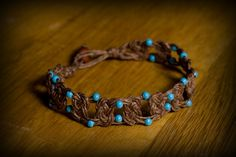 Brown hemp bracelet w/blue metal beads.  7.5 inches.  SOLD.  Email me for more info: dkwilson68@hotmail.com