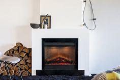 Moderne elektrische kachel als sfeerbrenger in de huiskamer, strak model van Faber   Tibas haarden & kachels Gouda