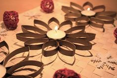 toilet paper roll flowers. Maybe put a hurricane glass in the middle so you can easily change out the candle?