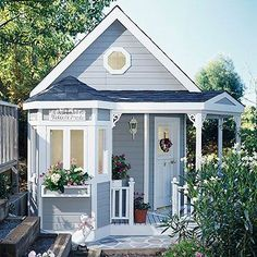 Too cute tiny house. Love all the architectural details, like the porch railing, the porthole window and the window box.