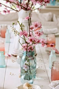 A Cherry Blossom themed wedding on the MEG Wedding Jewelry blog. Luscious cherry blossom center pieces.