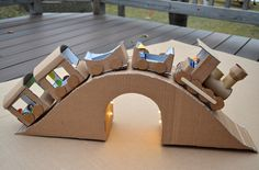 cardboard train with lighted tunnel. I wonder if I know any kids who'd like this... ;) Also on this site - lots of other totally AMAZING cardboard projects.