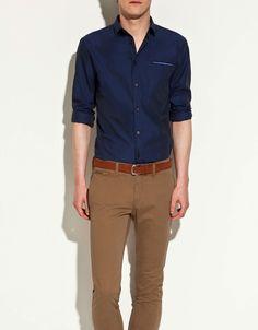 Brown Pants, Blue Shirt
