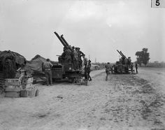 MINISTRY INFORMATION FIRST WORLD WAR OFFICIAL COLLECTION (Q 177) Two 13-pounder 9-hundredweight Anti-Aircraft guns about to fire on hostile aircraft. July 1916.