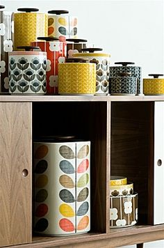 Orla Kiely Kitchenware - - Orla Kiely 1 Litre Linear Stem Yellow Storage Jar inclusive delivery The perfect size for tea bags, coffee, rice and pulses, these gorgeous ceramic jars have dark wood lids with a rubber seal….