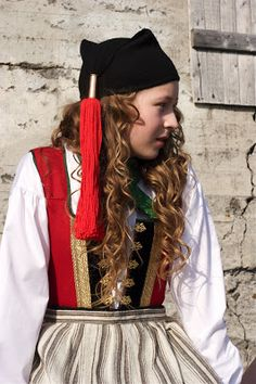 Europe | Portrait of a girl wearing traditional clothes and hat, Iceland