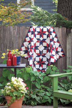 Designer Diane Knott pieced this patriotic quilt while watching the winter Olympics. The large blocks are based on the traditional Ice Crystal quilt block, and are made up of simple triangle-squares rather than diamonds. Diane says this is a great way to use up patriotic scraps. Look for Team USA in Scrap Quilts Spring '15.