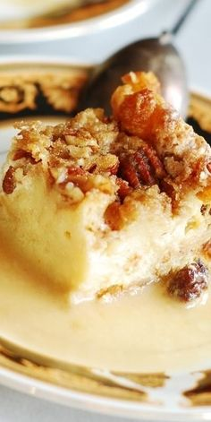 Make this for my mommy for Christmas! Woman loves bread pudding way too much lol. My favorite bread pudding recipe! With white chocolate, caramelized pecans, raisins, and whiskey cream sauce! Perfect for the holidays! Köstliche Desserts, Delicious Desserts, Dessert Recipes, Holiday Desserts, Plated Desserts, White Chocolate Bread Pudding, Chocolate Liqueur, Chocolate Cream, Whiskey Chocolate