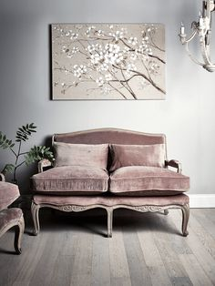 With an intricately carved, limewashed mango wood frame and luxurious, soft blush mink upholstery, our occasional sofa will make a beautiful addition to your living space. Complete with two cosy seat cushions and two comfortable backrest cushions, the unique design makes this a beautiful addition to our Loire Furniture Collection.