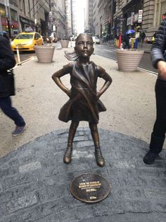 State Street installed a statue of a girl in front of the Wall Street bull in downtown Manhattan.  Photo: Rachael Levy