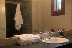 in the bathroom. Decor, Furniture, Bathroom Lighting, Suites, Home, Lighted Bathroom Mirror, Bathroom Mirror, Bathroom, Mirror