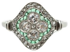 A really finely made platinum Art Deco ring with four well matched diamonds in the middle then tiny baguette cut emeralds with an outside line of rose diamonds. Rings such as this one are very sought after as it is all about the design.