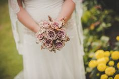 Dusky pink roses in the bride's bouquet for a 1920s vintage theme wedding at Goldsborough Hall. Flowers by Twisted Willow