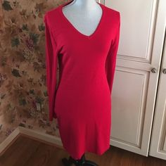 little red sweater dress  84% Rayon, 16% Nylon. No stains or rips. Making room in my closets. Smoke and pet free home. If you have any questions feel free to ask. Sofia Vergara Dresses Mini