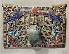 Pectoral decorated with winged scarab, protected by the goddesses Isis and Nephthys, made from gold cloisonne with glass-paste, from the tomb of the pharaoh Tutankhamun, discovered in the Valley of the Kings, Thebes, Egypt, North Africa, Africa
