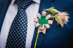 Groom's ribbon buttonhole finished off with an Irish shamrock made from green felt. See more here: Pearls and Lace Pink Love Birds Wedding at Langkloof Roses | Confetti Daydreams ♥  ♥  ♥ LIKE US ON FB: www.facebook.com/confettidaydreams  ♥  ♥  ♥ #Wedding #RealBride #RealWedding #Pink