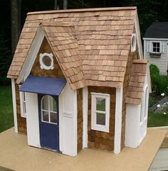 Buttercup Dollhouse with nautical/New England exterior.
