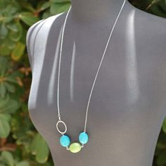Found this on etsy and I thought it was pretty. Long Turquoise Necklace Long Sterling Silver by georgiedesigns, $42.00