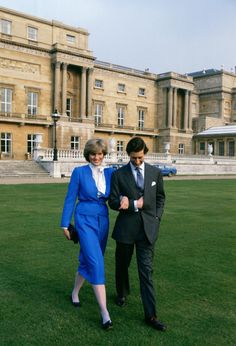 Vogue:  Lady Diana Spencer and the Prince of Wales-On the day they announced their engagement, Lady Diana Spencerwears a dress by Cojana. February 1981. Photo: Tim Graham/Getty Images