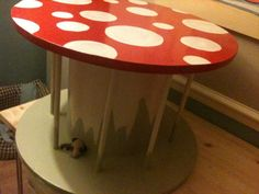 Children's play table with storage for books - Repurposed cable reel.