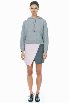 Edith skirt by Harmony Paris. Grey + pink wool origami style mini skirt with hip pockets and a back zipper. Fully lined.    Wool  Imported
