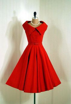 1950 day dress This dress has the silhouette in fashion during the decade, featuring a large skirt that hits around the knee, a fitted top with waistline at the natural waist.