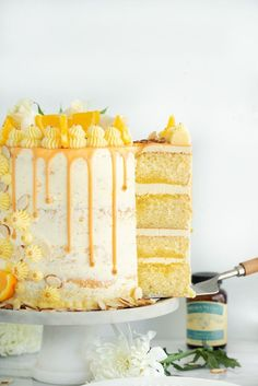 Vanilla Orange Almond Cake Recipe - Vanilla orange and almond soaked Vanilla Orange Almond Cake Recipe. Vanilla orange and almond soaked cake with layers of orange almond buttercream. Orange And Almond Cake, Cake Recipes, Dessert Recipes, Easy Cake Decorating, Cake Flavors, Orange Flavored Cake Recipe, Orange Layer Cake Recipe, Almond Cakes, Food Cakes